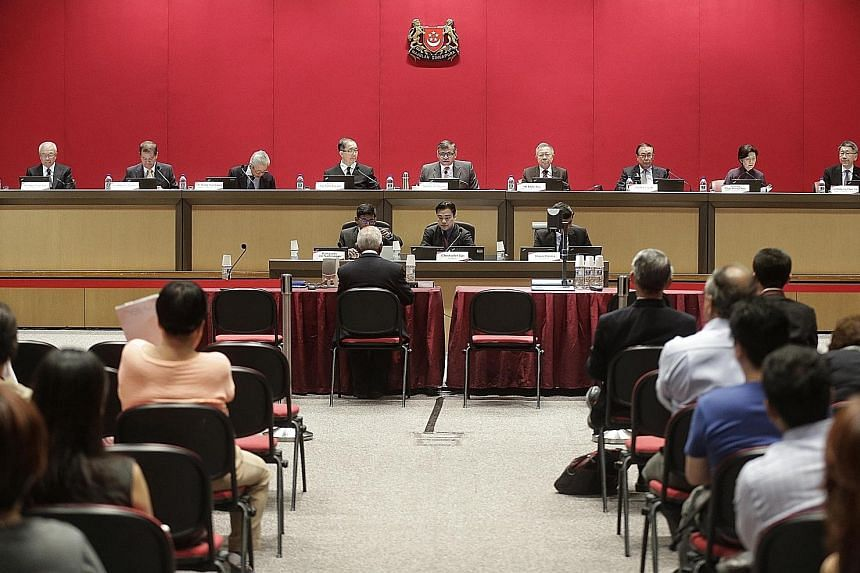 Former Cabinet minister S. Dhanabalan (seated, with back to camera) speaking at a Constitutional Commission hearing on the elected presidency. The commission's members are (from left) Mr Chua Thian Poh, Mr Abdullah Tarmugi, Mr Wong Ngit Liong, Justic