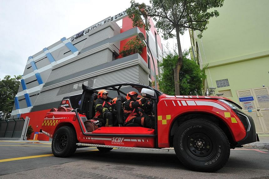 SCDF personnel in a Red Rhino at Sentosa's first fire station yesterday. The station has 20 personnel ready to be deployed at any one time, and houses two fire engines, a fire bike, an ambulance and a support vehicle.