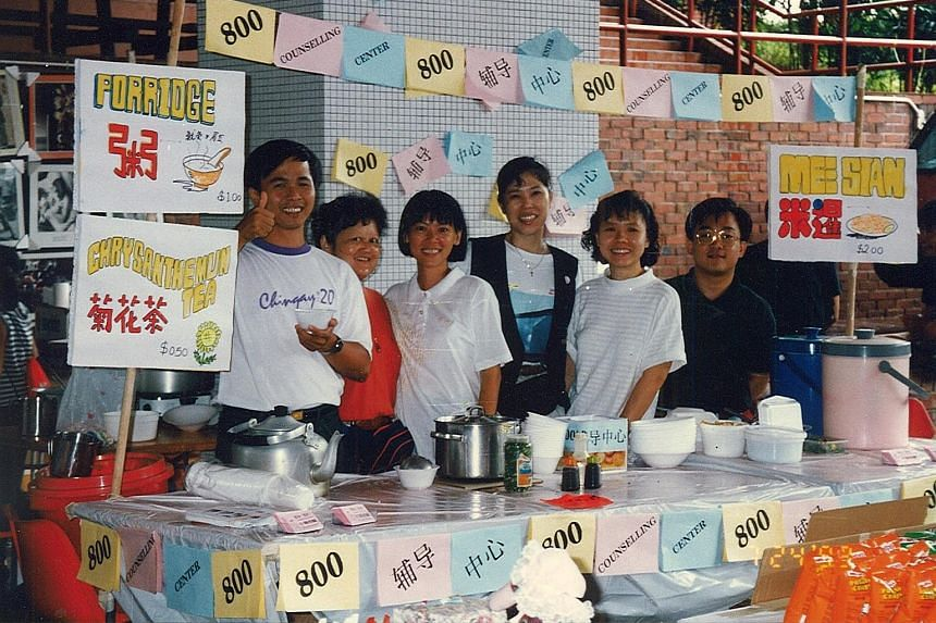 Care Corner staff manning a food booth at a community fun fair in 1992 to raise awareness of its outreach work. The organisation was founded by Rev Tan Tien Ser and a group of his friends.