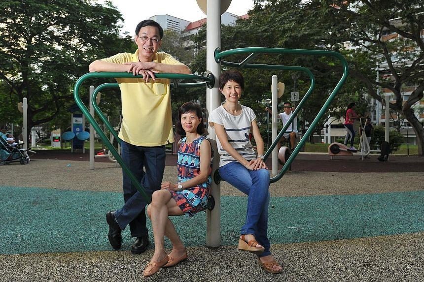 Taxi driver Kan Siew Luen, his wife, Madam Lai (centre), a China national who works as a hotel room attendant, and Care Corner volunteer Ms Chua, who was Madam Lai's local buddy in a one-year programme.