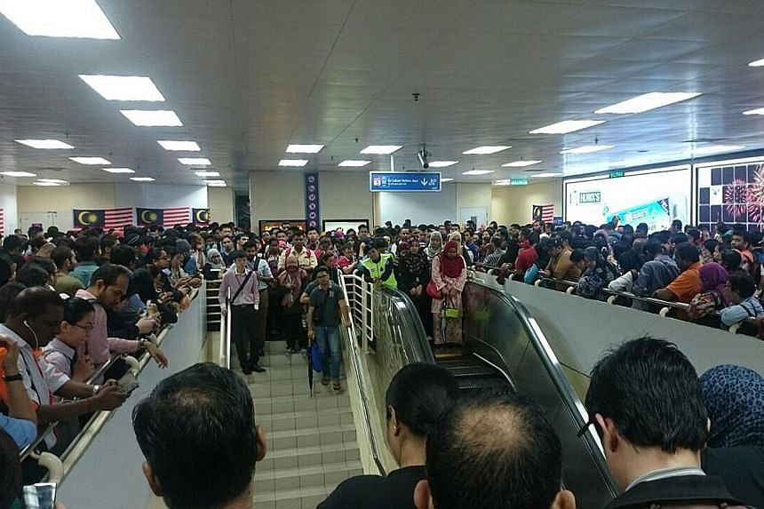 Commuters crowding the platform while waiting for trains to arrive at the Masjid Jamek LRT station in the Malaysian capital of Kuala Lumpur yesterday morning after a power trip caused a disruption. This happened at about 7am between Masjid Jamek and