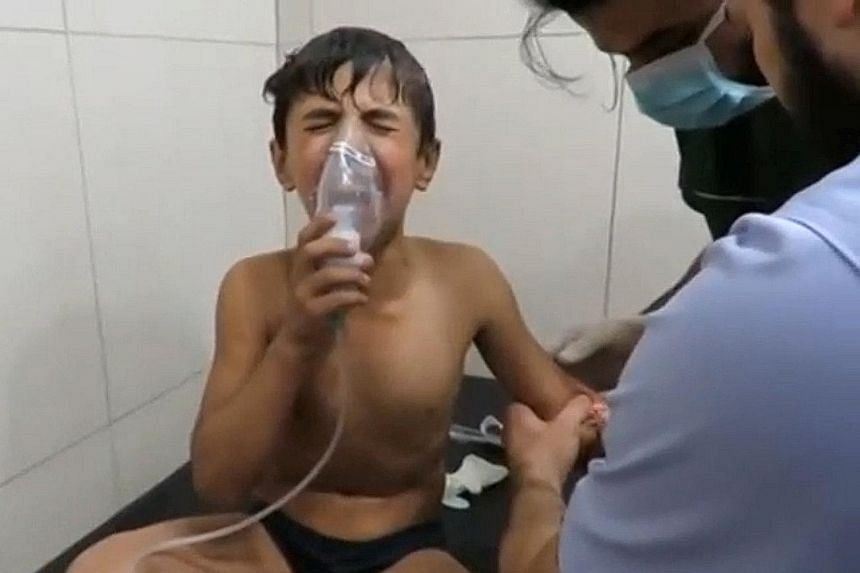 A screen grab of a video posted on social media said to be shot in Aleppo's Sukkari neighbourhood on Tuesday shows a boy in a hospital breathing through an oxygen mask after a suspected chlorine gas attack.