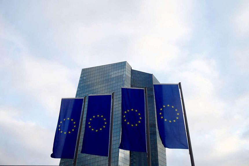 EU flags fly in front of the European Central Bank headquarters in Frankfurt, Germany on Dec 3, 2015.
