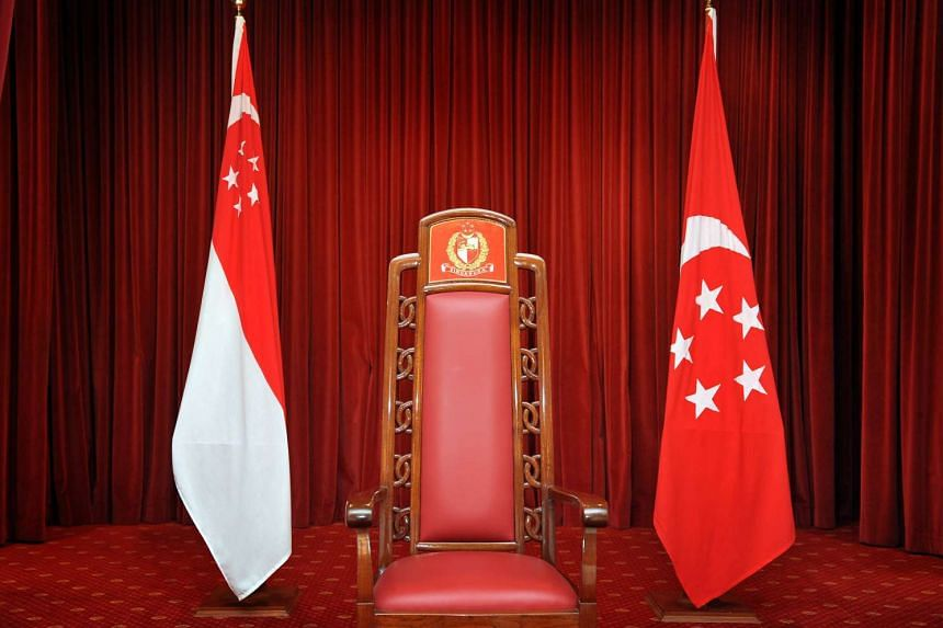The Presidential chair flanked by the State Flag (left) and the Presidential Standard (right) at the Istana on Aug12, 2011.