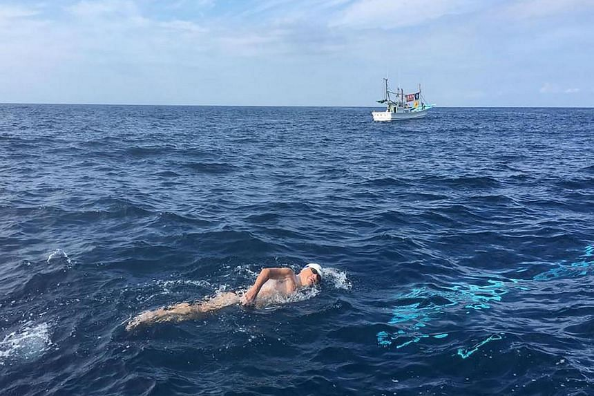 73-year-old Japanese swimmer Toshio Tominaga swimming in his challenge to become the world's oldest person to swim across the country's Tsugaru Strait.