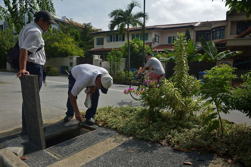 NEA officers checking for potential mosquito breeding sites at the Elite Terrace estate in Siglap on Sept 8, 2016.