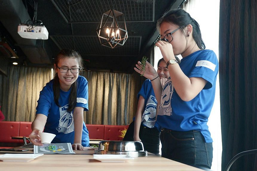 Naval Base Secondary school students smelling and guessing herbs and sauces used in cooking at the Kitchen training lab in 9th Avenue.