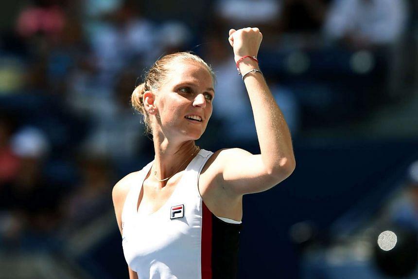 Karolina Pliskova of Czech Republic celebrates defeating Ana Konjuh of Croatia.