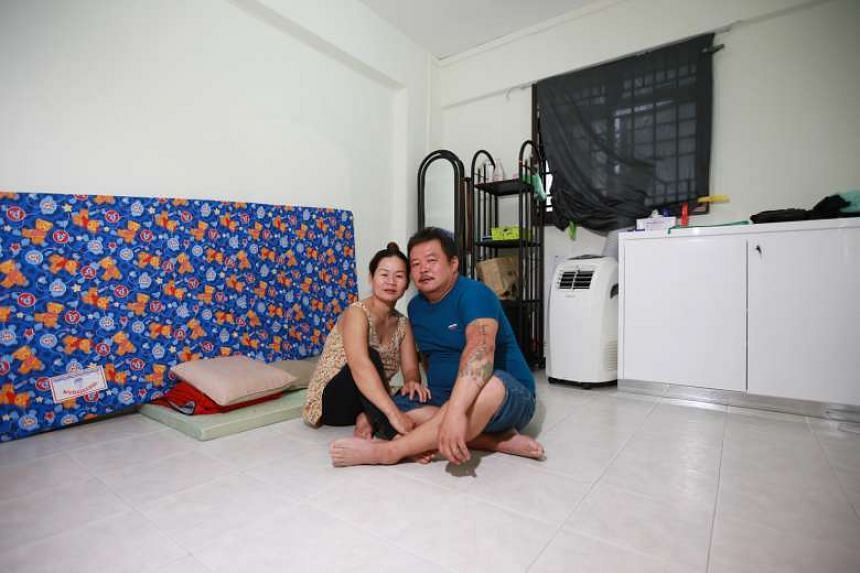 Mr and Mrs Ong in their temporary new home in Bedok North. They now have a baby son who was born on Aug 17.