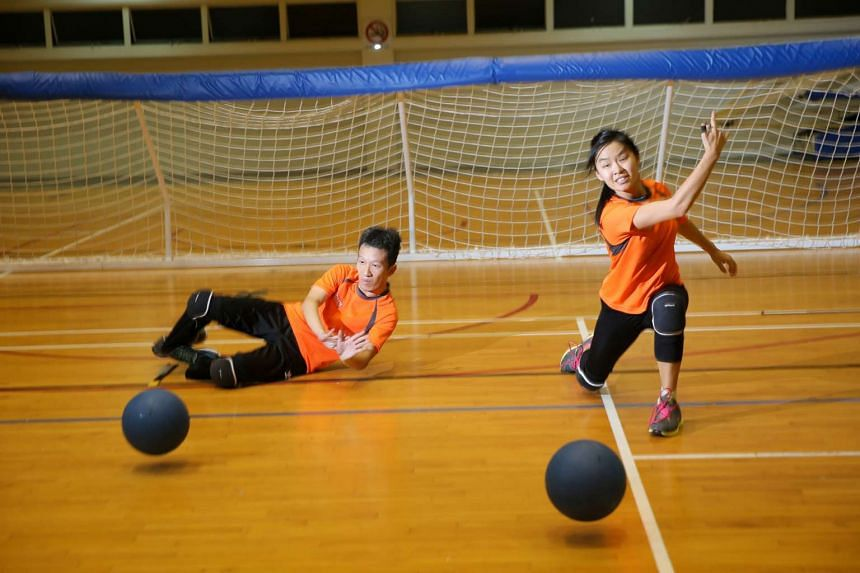 Stephan Chen, 33, (left) and Inez Hung, 24, (right) playing goalball. They picked up the sport after the Asean Para Games last year. They represent the new wave of disabled people taking part in para sports.
