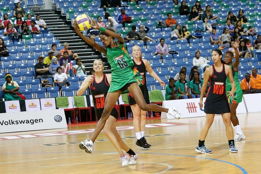 Zambia goal shooter Hellen Banda catches a ball during the Mission Foods Nations Cup match against Canada     yesterday. Banda, 25, shot 52 out of 53 attempts during Zambia's 78-26 victory.