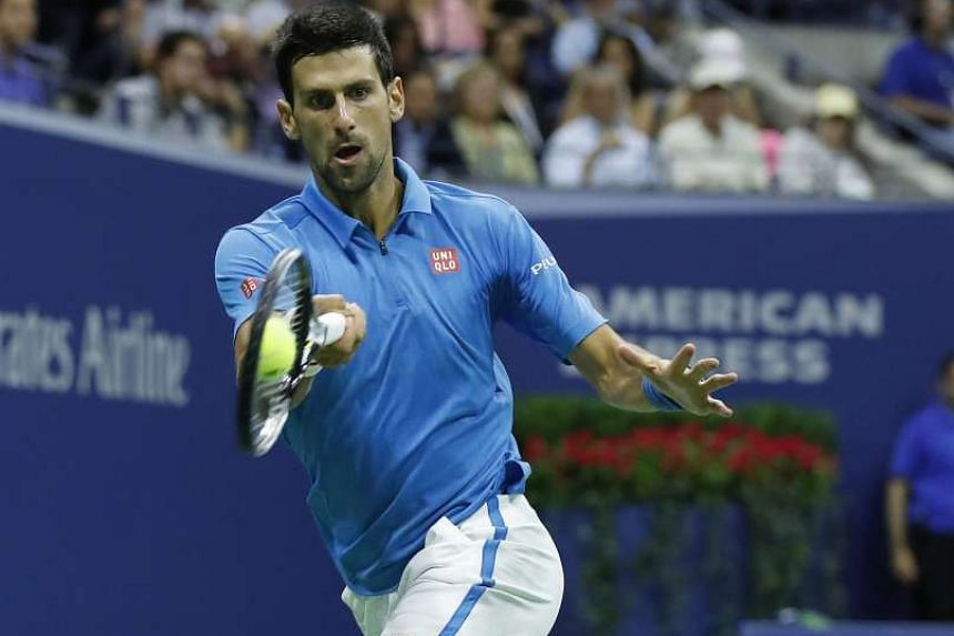 Novak Djokovic hits a running forehand against Jo-Wilfried Tsonga of France during their truncated quarter-final at Flushing Meadows on Tuesday. The Serb took the first two sets 6-3, 6-2 before the Frenchman retired after receiving on-court treatment for