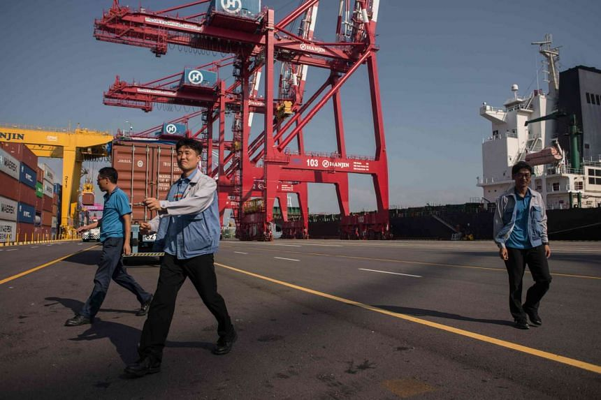 Workers at the Hanjin Incheon Container Terminal in the South Korean capital Seoul. Hanjin, one of the world's biggest shipping lines, filed for bankruptcy protection last week in Seoul.
