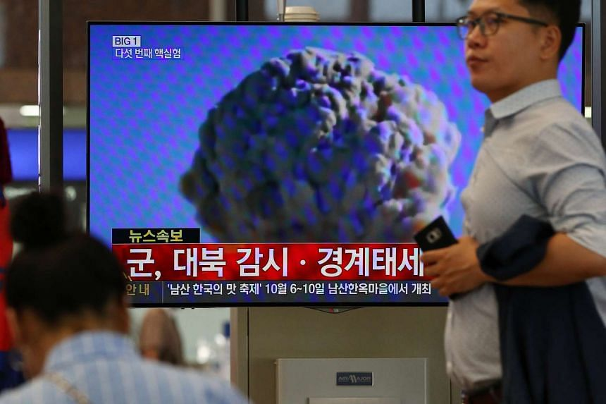 A news broadcast on North Korea's nuclear test is shown on a screen at Gimhae International Airport in Busan, South Korea on Sept 5, 2016.