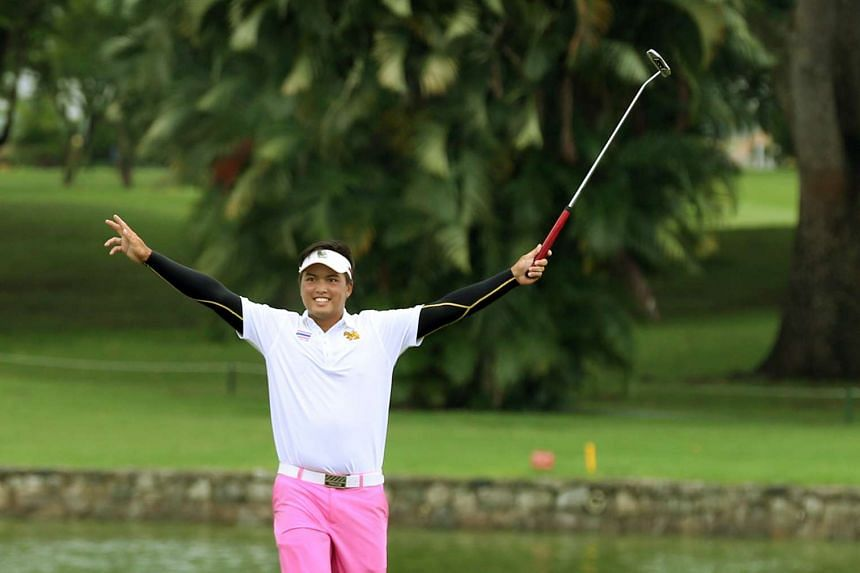 Thailand's Napong Sriparsit celebrating a birdie on the 18th hole on the final day of the Putra Cup.