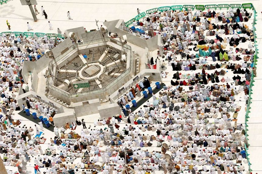 Muslim pilgrims pray during Friday prayers at the Grand mosque in Mecca on Sept 9, 2016.