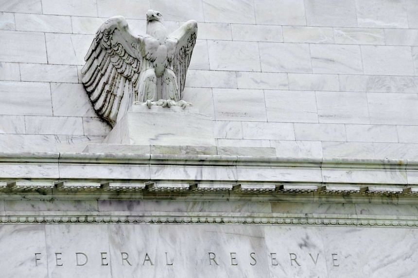 This file photo taken on Aug 9, 2011 shows the US Federal Reserve building in Washington, DC. The Federal Reserve wants Goldman Sachs and other US banks to stop buying stakes in companies.