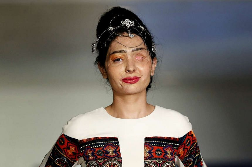 Indian model and acid attack survivor Reshma Quereshi presents a creation from Indian designer Archana Kochhar's collection.