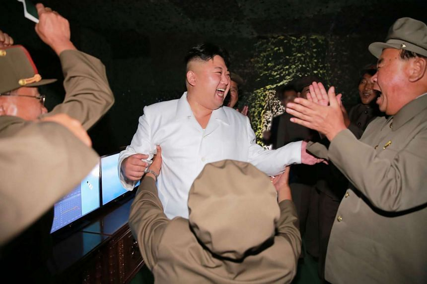 This undated file photo released from North Korea's official Korean Central News Agency (KCNA) on Aug 25, 2016 shows North Korean leader Kim Jong Un laughing as he inspects a test-fire of strategic submarine-launched ballistic missile at an undisclos