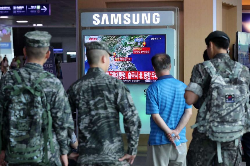 Civilians and soldiers watching a television broadcast of an artificial earthquake in North Korea being detected at Seoul Station, in Seoul, South Korea, Sept 9, 2016. A magnitude-5.3 earthquake was detected in northeastern North Korea on Sept 9, the