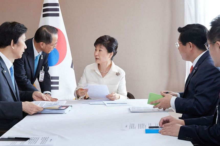 South Korean President Park Geun Hye presiding over an emergency meeting at her residence in Vientiane, Laos, in this handout picture provided by the Presidential Blue House and released by Yonhap on September 9, 2016. the Presidential Blue House.