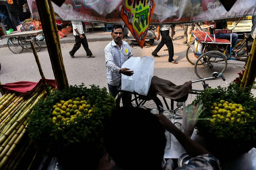 Ram Babu, 52, sells ice to roadside vendors in the old quarters of New Delhi on June 4, 2016.