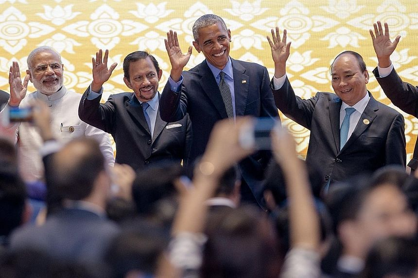 (From left) Indian Prime Minister Narendra Modi, Brunei Sultan Hassanal Bolkiah, Mr Obama and Vietnamese Prime Minister Nguyen Xuan Phuc were among the leaders at the 11th East Asia Summit in Vientiane, Laos, yesterday.
