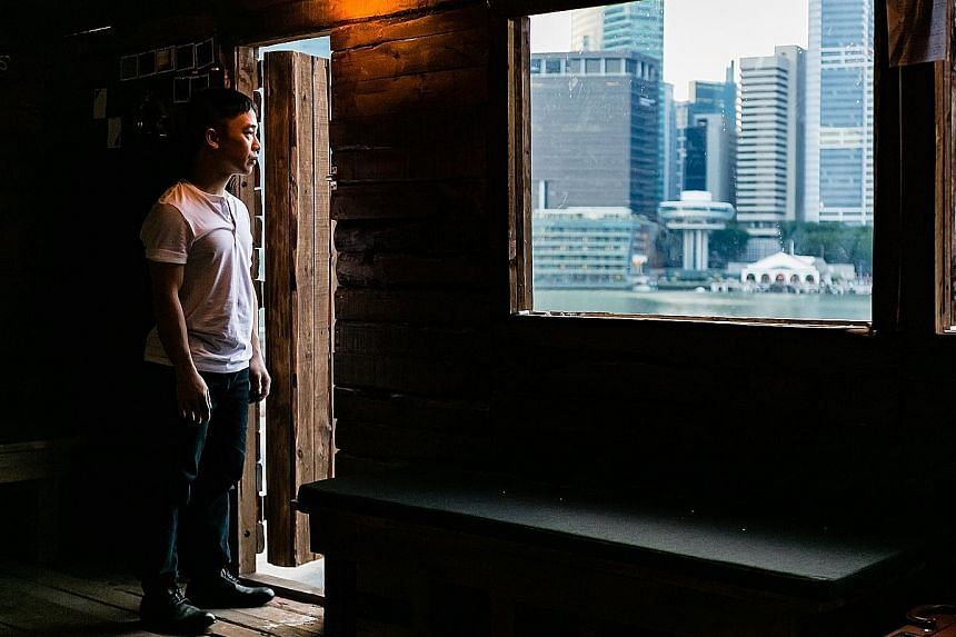 Actor-director Oliver Chong ponders life together with his audience in a wooden cabin.