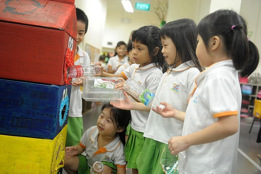 Cookie monster is now eating more than just cookies, at least at the Admiralty Link branch of My First Skool. Its diet now comprises sheets of paper and cardboard. Teachers and pupils at the kindergarten designed a recycling bin using characters from
