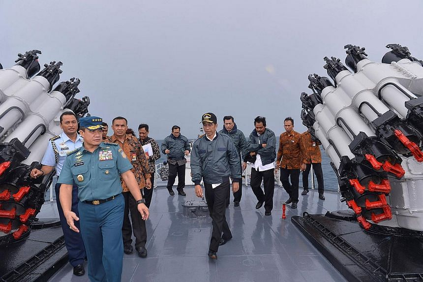 President Joko (centre) on the deck of the Indonesian Navy ship KRI Imam Bonjol with some members of his Cabinet in the waters of Natuna Islands on June 23. His apparent show of force signalled Indonesia's determination to safeguard the Natuna Island