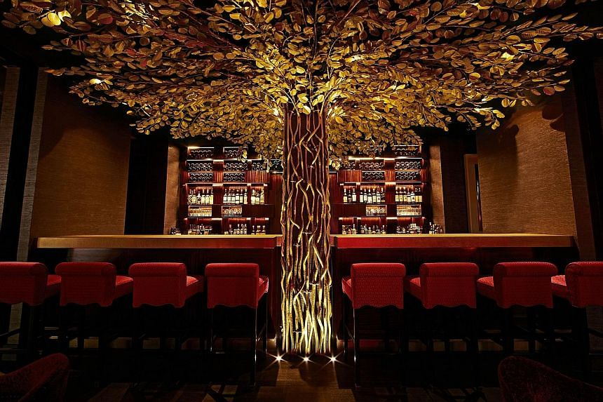 An artist's impression of The Duxton Club's Duxton House lobby (above), and the bar at Hotel Vagabond (left). The two hotels are the first to be launched under Starwood's The Luxury Collection and Tribute Portfolio brands in Singapore.