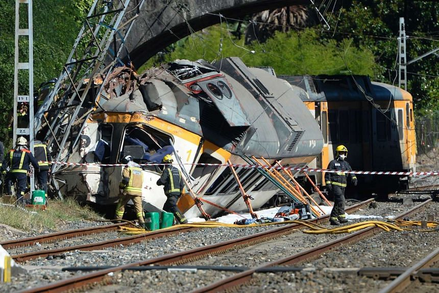 Firefighters and rescuers inspect the wreckage of a train derailed in O Porrino, northwestern Spain, leaving at least four people dead and some 50 injured, on Sept 9. -