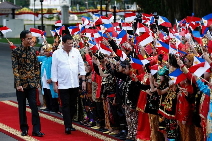 Indonesian President Joko Widodo (L) welcomes visiting Philippines President Rodrigo Duterte to the presidential palace in Jakarta on Friday, Sept 9. -