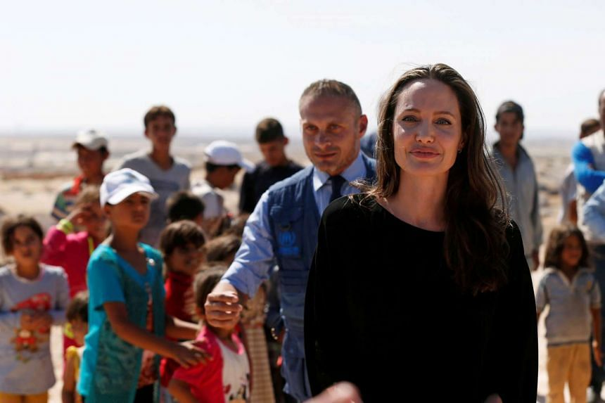 Actress Angelina Jolie leaves after her news conference at Azraq refugee camp for Syrians displaced by conflict.