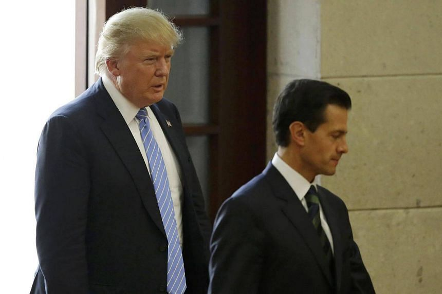 US Republican presidential nominee Donald Trump and Mexico's President Enrique Pena Nieto arrive for a press conference at the Los Pinos residence in Mexico City on Aug 31.