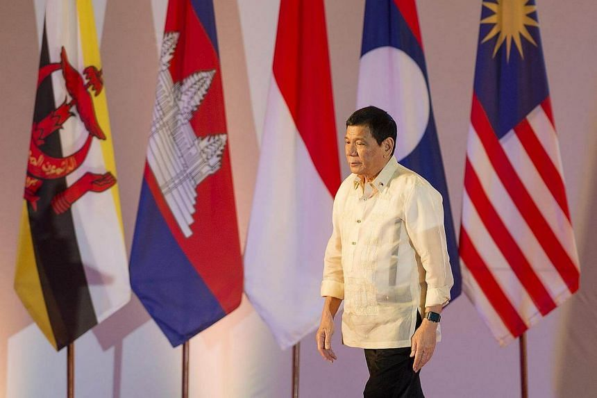 Philippine President Rodrigo Duterte leaves after the closing ceremony of the ASEAN and handover of the ASEAN chairmanship to the Philippines in Vientiane on Sept 8, 2016.