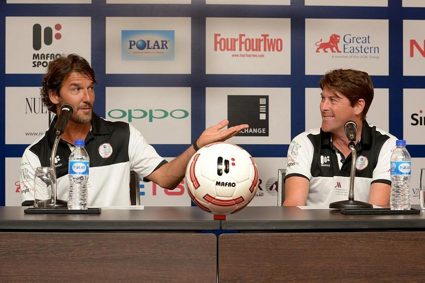 England's Darren Anderton (right) and Germany's Karl-Heinz Riedle at the press conference for The Battle Of Europe 2016 at the Marriott Hotel on Sept 9, 2016.