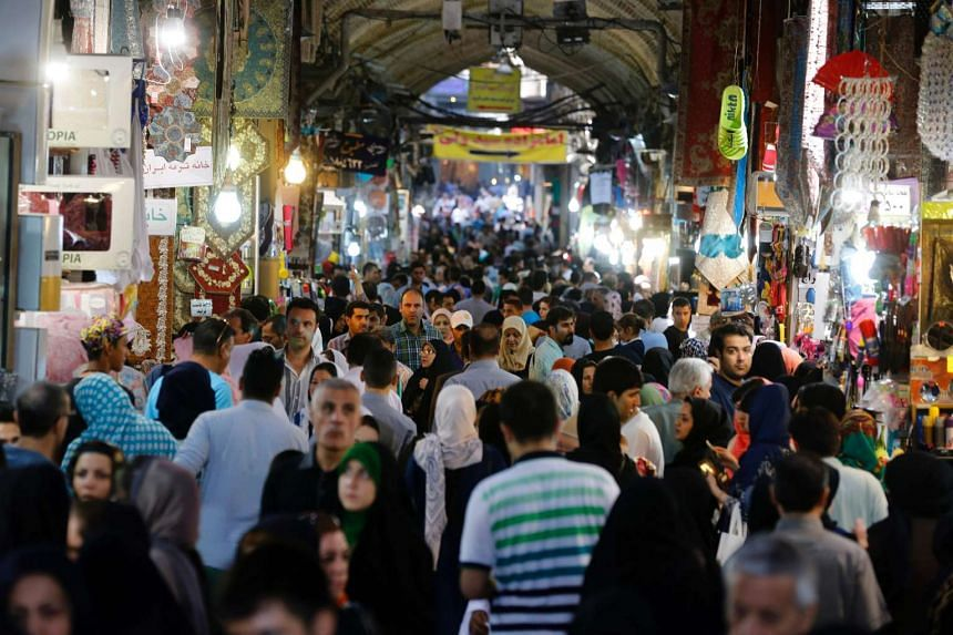 Iranians shop in Teheran's ancient Grand Bazaar on July 11, 2016. Iran made its nuclear commitments in 2015 in exchange for sanctions relief.