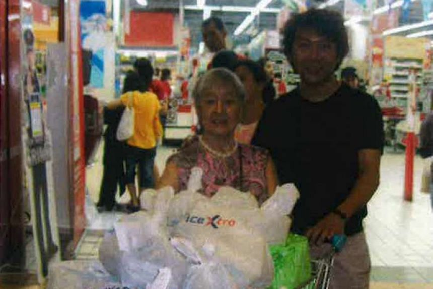A photo submitted by his lawyer in court shows Yang Yin accompanying Madam Chung Khin Chun as she goes grocery shopping.