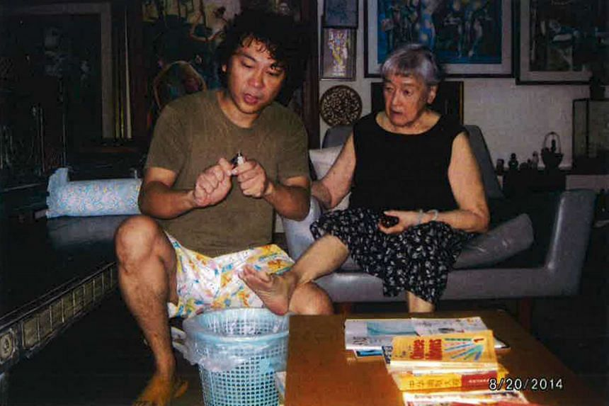 A photo submitted by his lawyer in court shows Yang Yin as he helps Madam Chung Khin Chun cut her toenails.