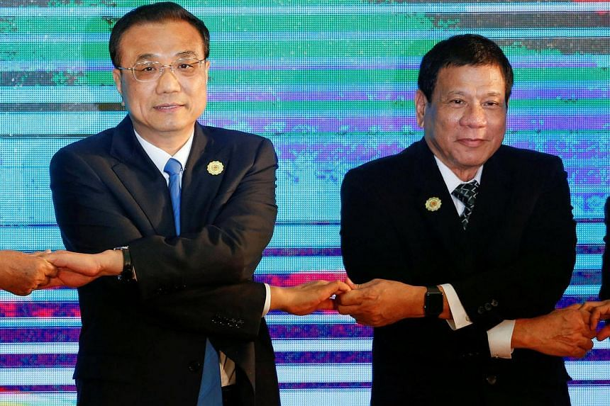 Chinese Premier Li Keqiang (left) and Philippines President Rodrigo Duterte posing for a photo during the Asean Plus Three Summit in Vientiane, Laos on Sept 7, 2016.