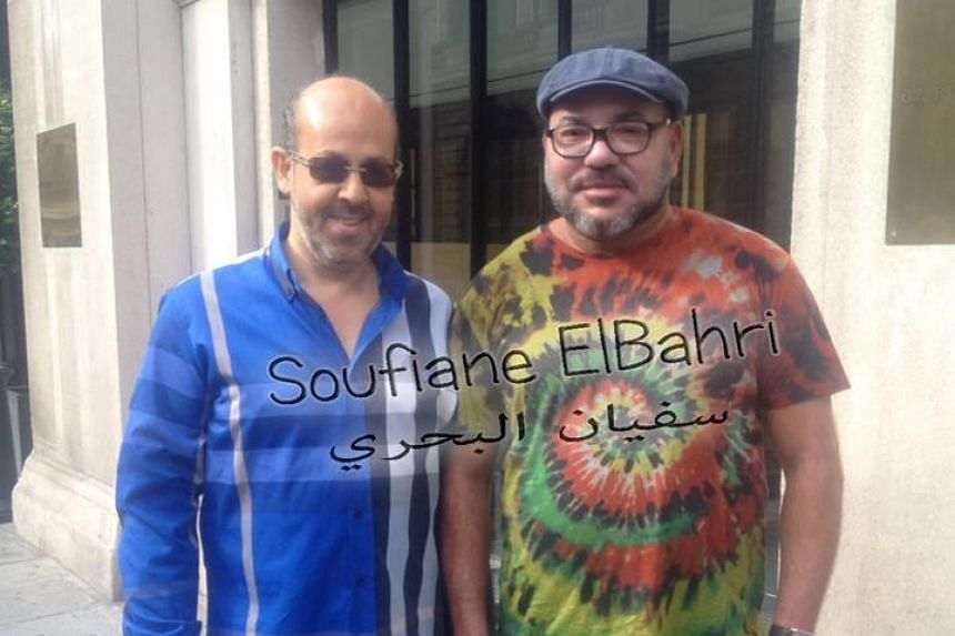 Morocco's King Mohammed VI (right) posing with an admirer in Paris.