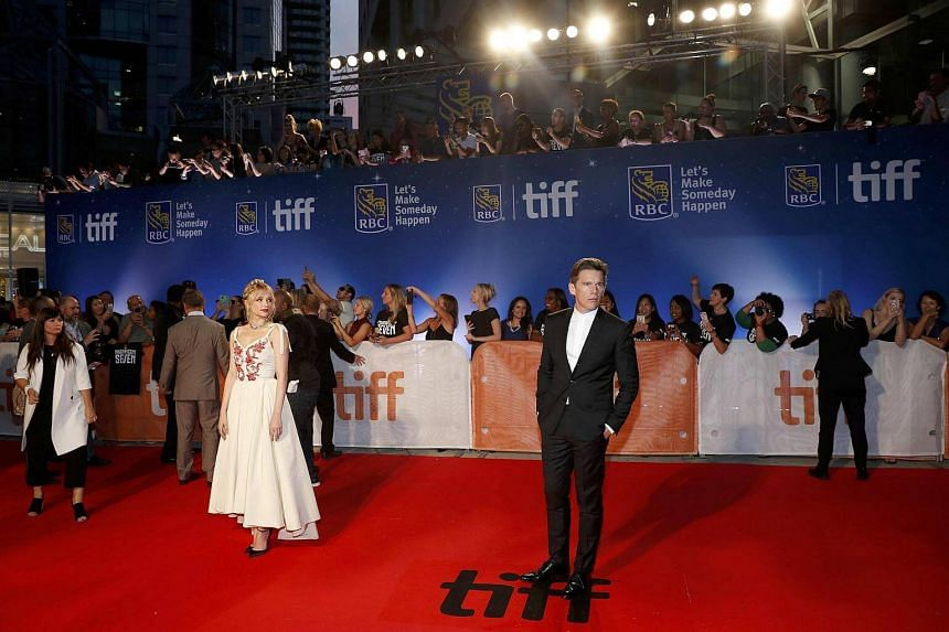 Haley Bennet (left) posing with Ethan Hawke on the red carpet for the film The Magnificent Seven during the 41st Toronto International Film Festival, in Toronto, Canada, on Sept 8, 2016.