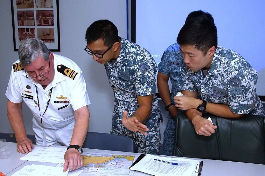 The RSN and RAN officers working together during the exercise.