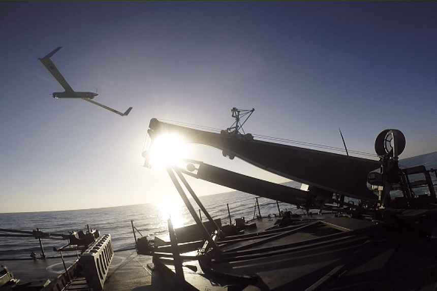 The ScanEagle unmanned aerial vehicle (UAV) being launched off RSN's Victory-class missile corvette, RSS Vigour.