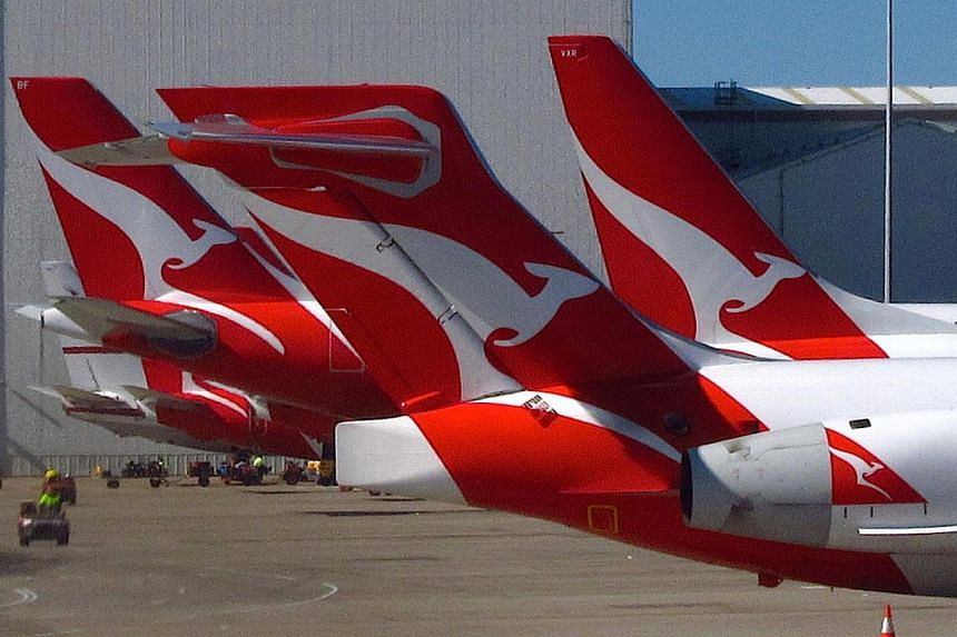 Qantas planes parked at the Qantas Domestic Terminal located at Sydney Airport, Australia.