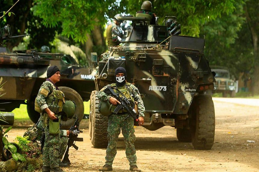 Philippine soldiers standing next to an Armored Personnel Carrier in Jolo, Sulu province, Mindanao, as they prepare for an operation against the extremist Abu Sayyaf group on Sept 5, 2016.