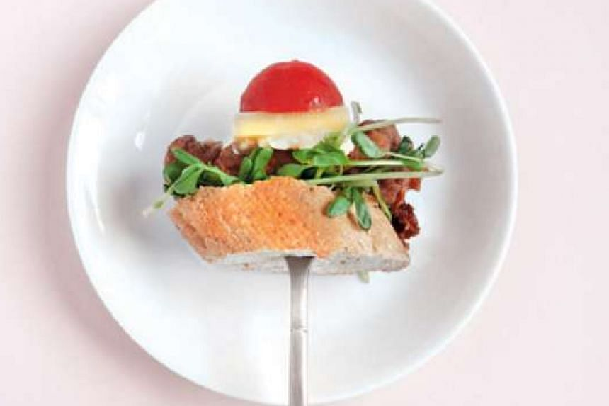 Tapas such as this one by Canape, with shrimp paste fried chicken, pea shoots, cherry tomato and garlic aioli as ingredients, will be sold at $3 each at I Eat Design.
