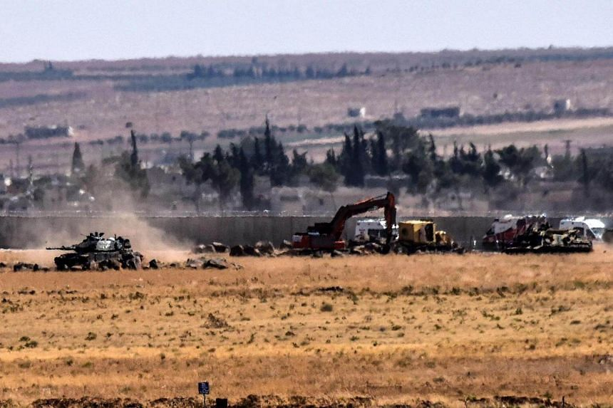 Turkish tank coming from Syria during clashes between Turkish army and ISIS militants on Sept 4, 2016 at Elbeyli, in the southern region of Kilis.