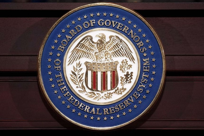 This file photo taken on June 19, 2013 shows the seal of the Federal Reserve Board of Governors at the Federal Reserve Board Building in Washington, DC.